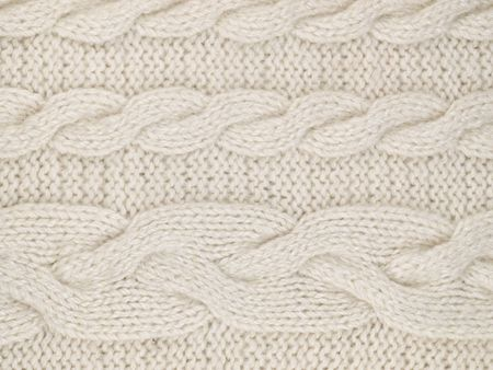 White  knitted with a pattern textured background  photo