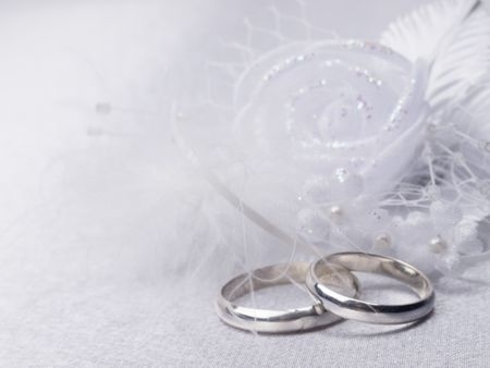Two silver weddings rings and floral  decoration photo