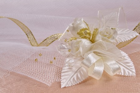 buttonhole: Weddings accessorie a buttonhole  on a lace background