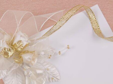 buttonhole: Weddings accessorie a buttonhole  on a card for invitation or congratulation Stock Photo