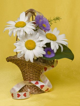 bouquet of flowers  in a small basket photo