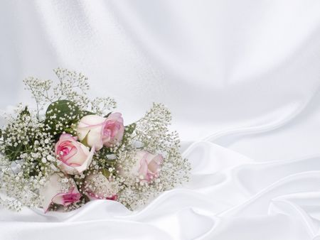 Beautiful bouquet on a background white silk Stock Photo