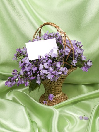 Card for text and Lilac flower  in a small basket photo