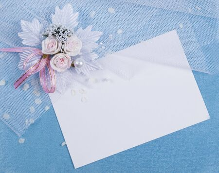White card for congratulation on a background from blue