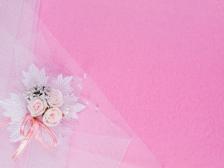 Weddings accessorie a buttonhole  on a pink background Stock Photo