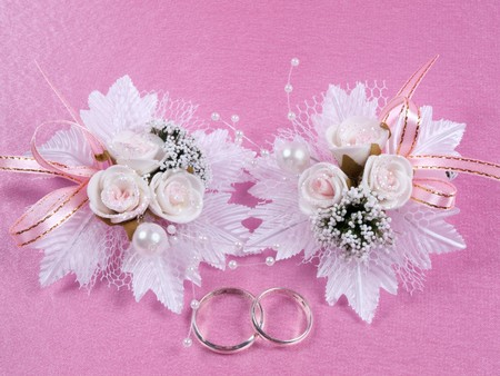 Weddings accessorie a buttonhole  on a pink background photo