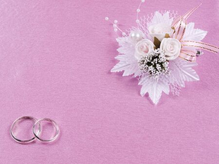 buttonhole: Weddings accessorie a buttonhole  on a pink background Stock Photo
