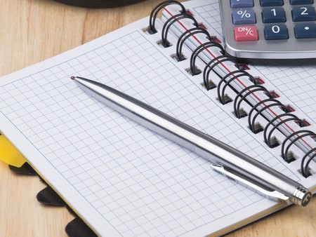 Opened business diary, pen and calculator Stock Photo - 7699628