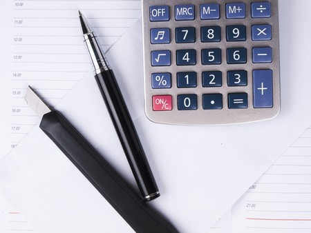 Opened business diary, pen and calculator Stock Photo - 7699622