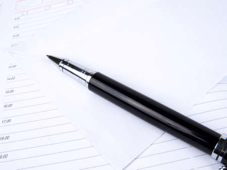 business diary and pen on a white background Stock Photo - 7699618