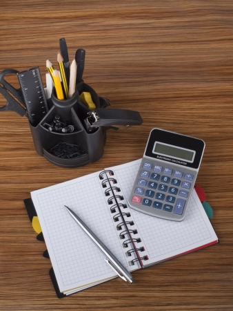 Desk organizer with office  tools, business diary, pen and calculator photo