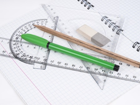 eraser mark: protractor, pen, pencil, rules and workbook page