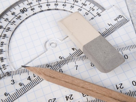 delineate: protractor,  pencil, rules and workbook page