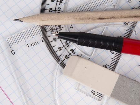 delineate: protractor, pen, pencil, rules and workbook page