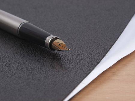Pen  and  black folder for documents