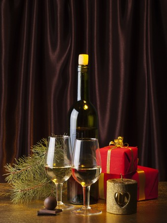 goldish: Two glasses and box with gifts on a goldish background