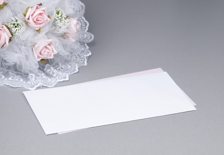 card for text and weddings accessories on a grey background photo