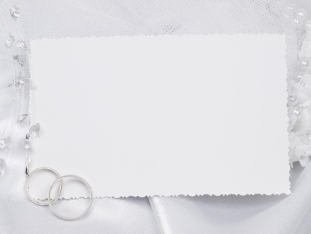Silver wedding rings on a card  photo