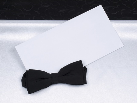 Card,  bow tie  on a background black and white silk Stock Photo - 8561344