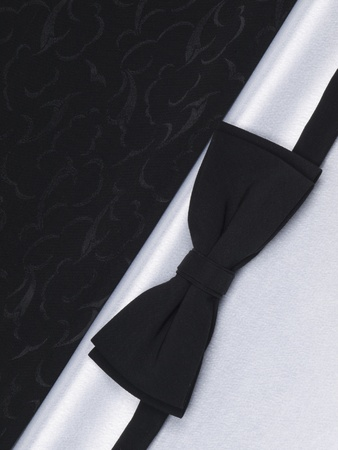 Bow tie  on a background black and white silk Stock Photo - 8561346