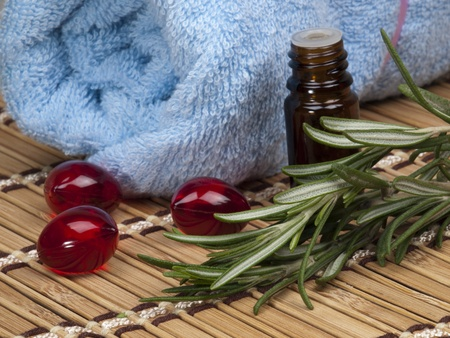 fresh rosemary and  vial with essential oil Stock Photo