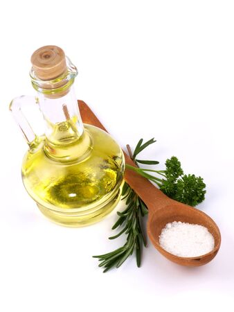 Branch rosmarinus, parsley  and a bottle of vegetable  oil isolated on white photo