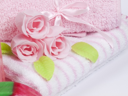 Convolute towels and soap as a flower of rose photo