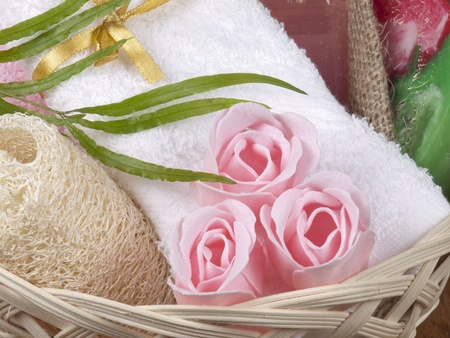 Spa concept with towel, soap as a flower of rose