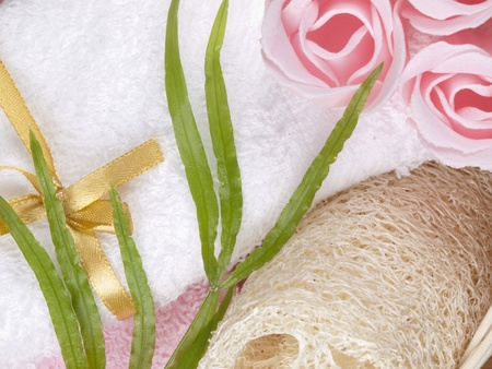 Spa concept with towel, soap as a flower of rose  photo