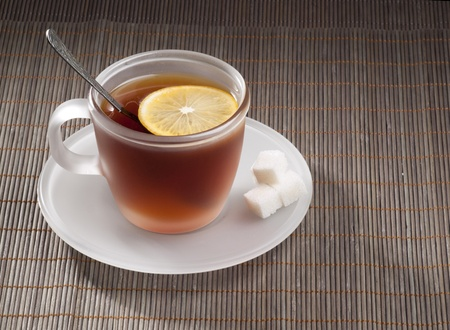 Cup with tea on a dark background photo