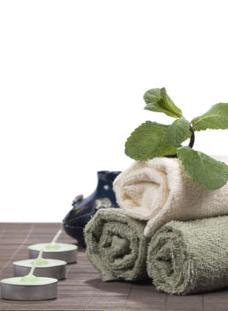 aquatic herb: Spa concept with candle, towel and by the sprig of mint