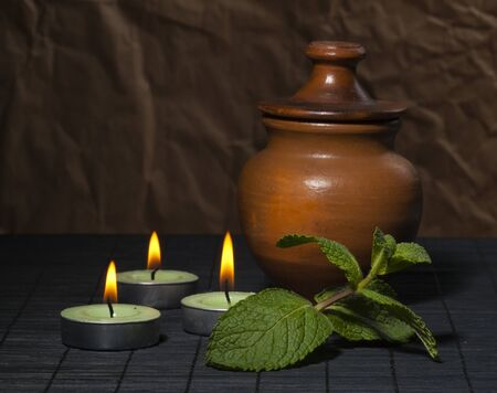 Spa concept with candles and mint