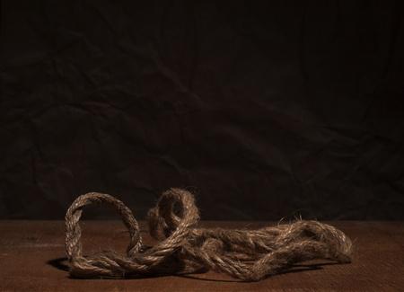 Rough hemp rope on a dark background Stock Photo - 9034648