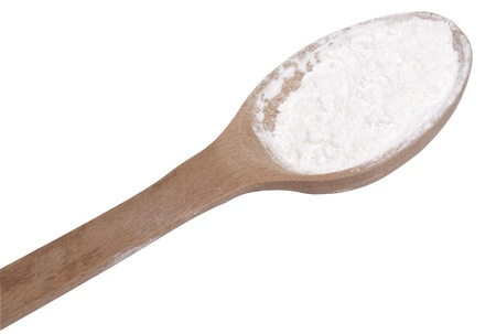 A wooden spoon with flour  isolated on white
