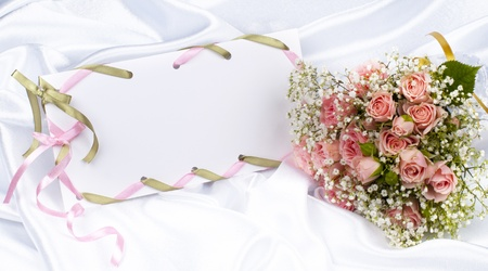 Beautiful bouquet and card for your text on a background white silk
