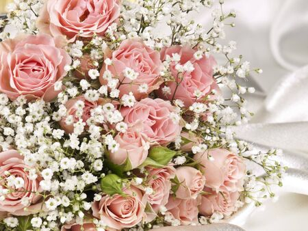 Beautiful bouquet on a background white silk photo