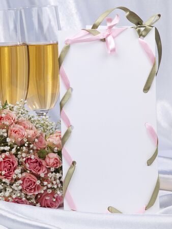 promising: White card, wedding accessories, boutonniere, buttonhole on a background from  satin Stock Photo