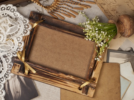 Still life with old pictures and frame for a photo