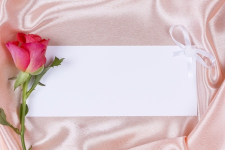 Beautiful rose on a background pink silk Stock Photo