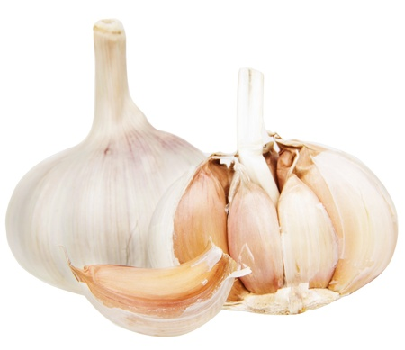 Fresh garlic bulbs on a light background