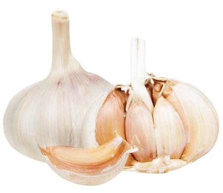 Fresh garlic bulbs on a light background