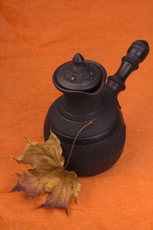 cezve: Ceramic Cezve on an orange background