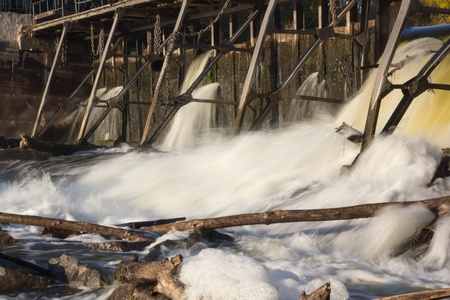 turbulent: Water spills over the dam. Turbulent flow