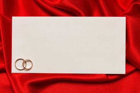 White card for congratulation on a background from red silk photo