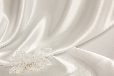 textile wedding background with pearls and flower from silk photo