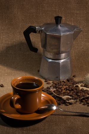 still life with a coffeepot coarse fabric photo