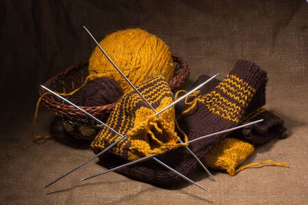 A basket with  knitting yarn and knitting needles photo