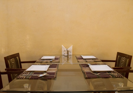 dinner table with a square plates photo