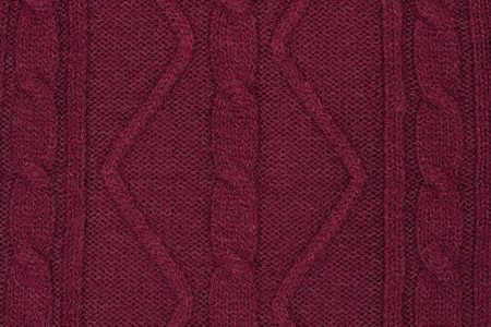 dense mats: vinous  knitted with a pattern textured background Stock Photo