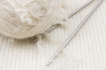 dense mats: White  knitted with a knitting needles and skein of wool